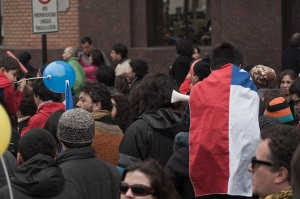 A small child wearing a Chilean flag in a peaceful protest of the education system.
